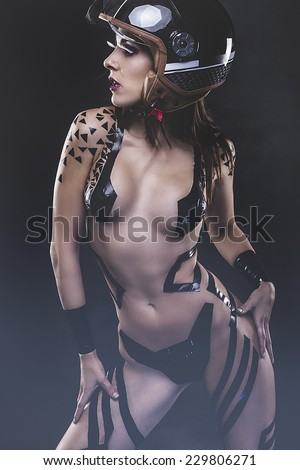sexy beautiful woman with bike helmet, naked and black strips - stock photo