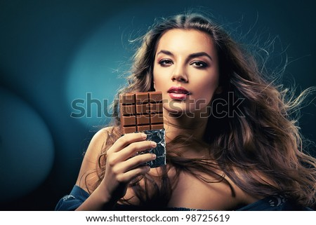 sexy beautiful woman with chocolate and wind
