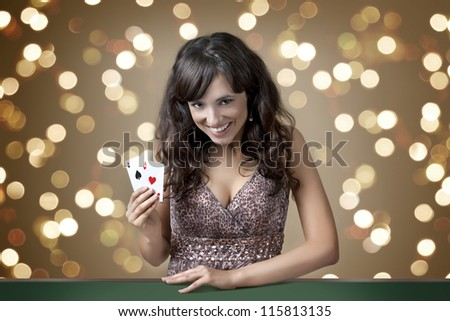 Sexy beautiful young girl in casino on the background bokeh - stock photo