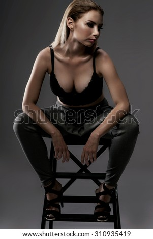 Sexy beautiful young woman posing in fashionable clothes. Studio shot.