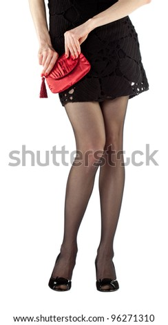 Sexy beautiful young woman wearing mini dress holding red handbag; closeup of hands and legs isolated on white - stock photo