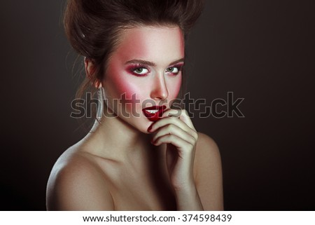 Sexy Beauty Girl with Red Lips and Nails. Provocative Make up. Glamour Style Photoshoot on dark background