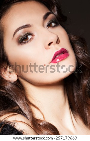 Sexy Beauty Girl with Red Lips. Luxury Woman with brown eyes. Retro fashion Brunette Portrait. Gorgeous Woman Face. Long curly hair. Shining make up. - stock photo