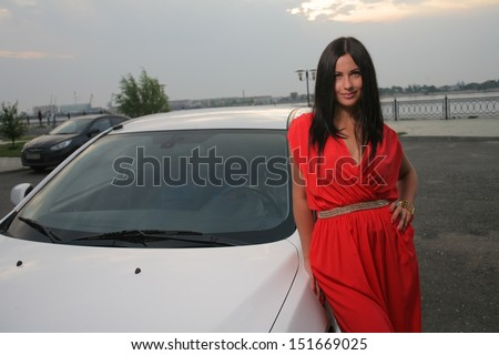 Sexy Beauty Woman In Fluttering Red Dress - Very Sexy Girl Outdoor - stock photo