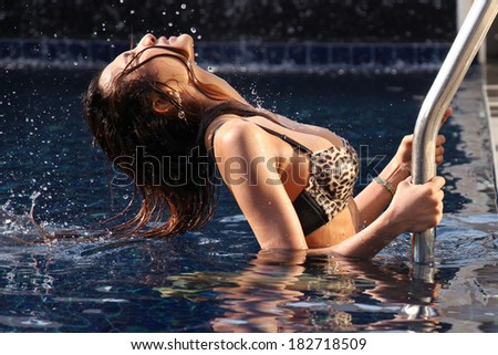 Sexy bikini young woman at swimming pool - stock photo