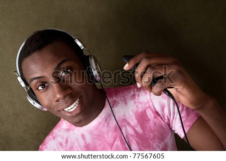 Sexy Black man with headphones and mp3 player