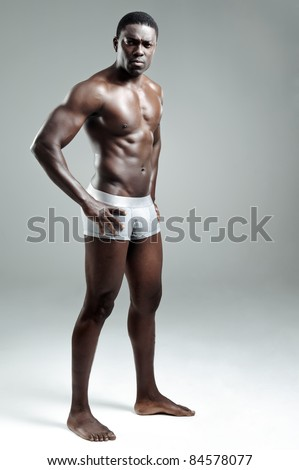 Sexy black model striking a pose in the studio - stock photo