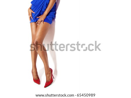 sexy black woman's legs  wearing blue dress and red shoes , on white - stock photo