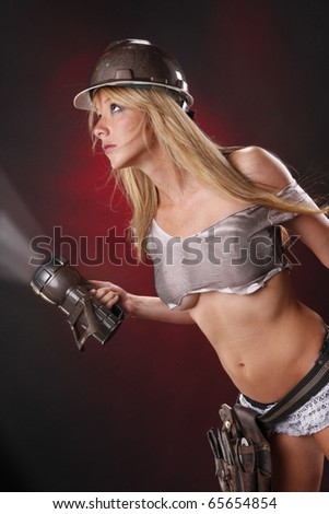 Sexy blond as glamorous utilities worker - stock photo