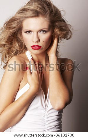 sexy blond girl with red lips on grey background - stock photo