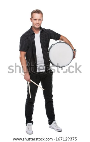 Sexy blond male drummer looking at camera. Holding white drum standing isolated over white background  - stock photo