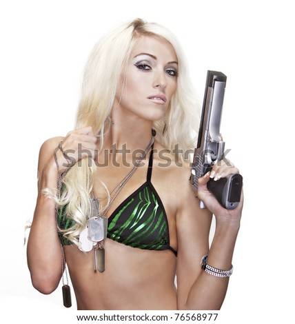 Sexy blond woman holding pistol gun - stock photo