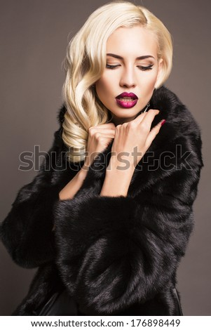 sexy blond woman in black fur coat - stock photo