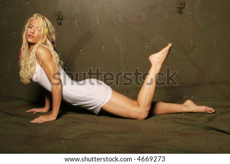 Sexy blond woman in mini dress - stock photo