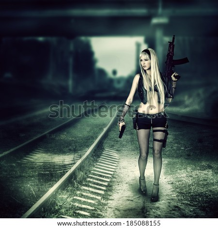 Sexy blond woman killer holding automatic and gun - stock photo