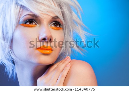 sexy blond woman portrait on blue background - stock photo