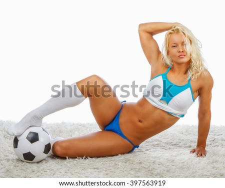 Sexy blond woman posing with soccer ball. - stock photo