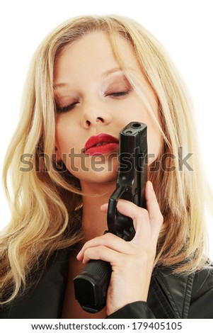 Sexy blond woman with handgun isolated on white background  - stock photo
