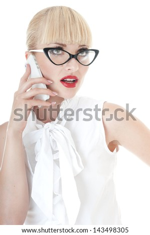 Sexy blonde business executive using smartphone  and wearing glasses on white background.