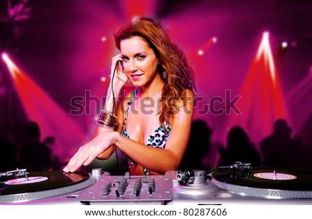 sexy blonde dj girl in the club - stock photo