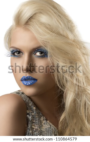 sexy blonde girl with euro flag make-up and glitter dress, she is turned of three quarters and looks in to the lens - stock photo