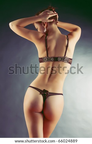 Sexy blonde in lingerie over blue background - stock photo