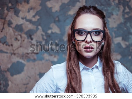 Sexy blonde studentwearing glasses looking at the camera - stock photo