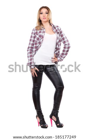 Sexy blonde wearing checked shirt and black pants. Isolated on white - stock photo