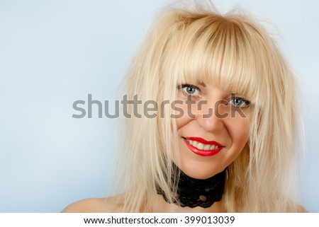 Sexy blonde with beautiful blue eyes and shaggy hair - stock photo