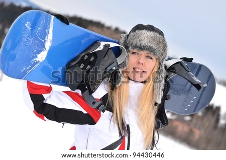 sexy blonde with snowboard - stock photo