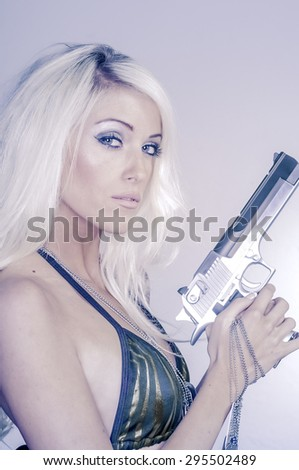 Sexy blonde woman holding gun