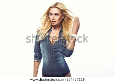 sexy blonde woman in jeans bodysuit and white watch. Fashion photo - stock photo