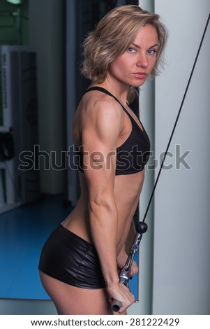 Sexy, blonde woman in the gym. Sports, health, a beautiful body. - stock photo