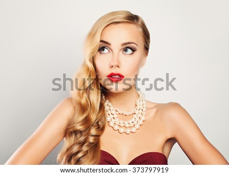 Sexy Blonde Woman Looking Up - stock photo