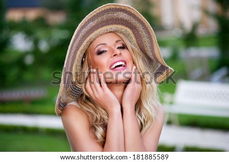 Sexy blonde woman with red lips and hat  - stock photo