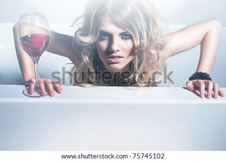 Sexy blonde woman with red wine - stock photo