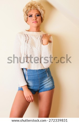 sexy blonde young girl at jeans smiling - stock photo