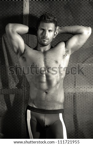Sexy body portrait of a very muscular handsome man - stock photo