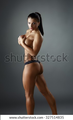 Sexy bodybuilder demonstrated her perfect body - stock photo