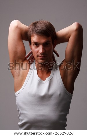 Sexy boy. Attractive young man on a grey background
