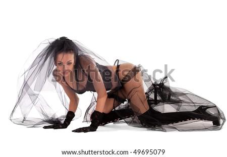 Sexy bride in black on studio floor - stock photo
