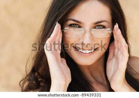 sexy brunette beautiful woman with long hair wearing glasses - stock photo
