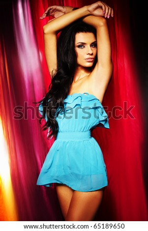 sexy brunette girl in colourful background - stock photo