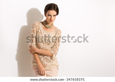 Sexy Brunette in lacing blouse with jewellery - stock photo