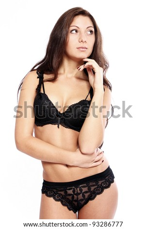 Sexy brunette in lingerie  over white background - stock photo