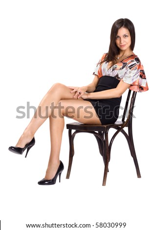 sexy brunette in mini seat on chair - stock photo