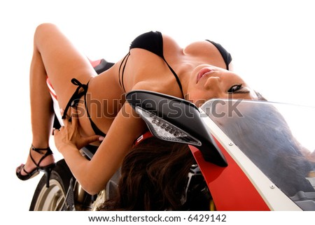 Sexy brunette on motorbike. - stock photo