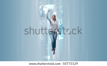 Sexy brunette operating data (Attractive young adults in futuristic interfaces / interiors series) - stock photo