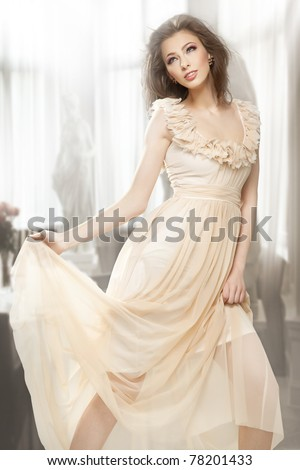 Sexy brunette posing in a gorgeous dress - stock photo
