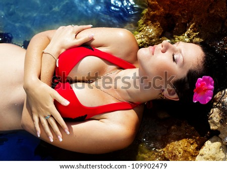 sexy brunette resting in the water
